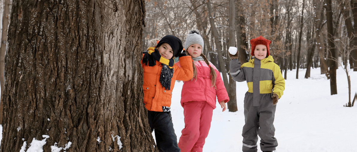 Kids playing in winter with snow