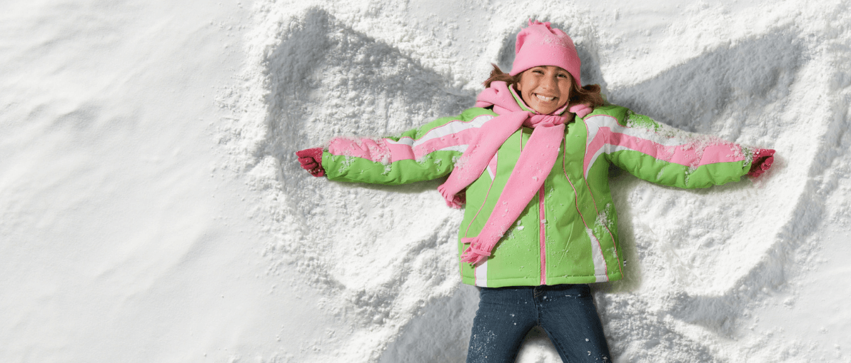 Child having fun in snow